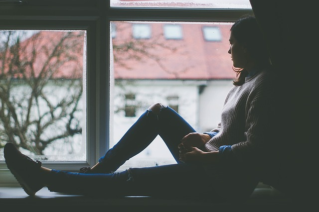 Depression girl in window